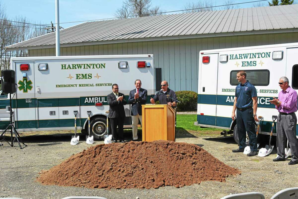 Officials look on at the groundbreaking ceremony for the new Harwinton EMS building during a ceremony Monday.