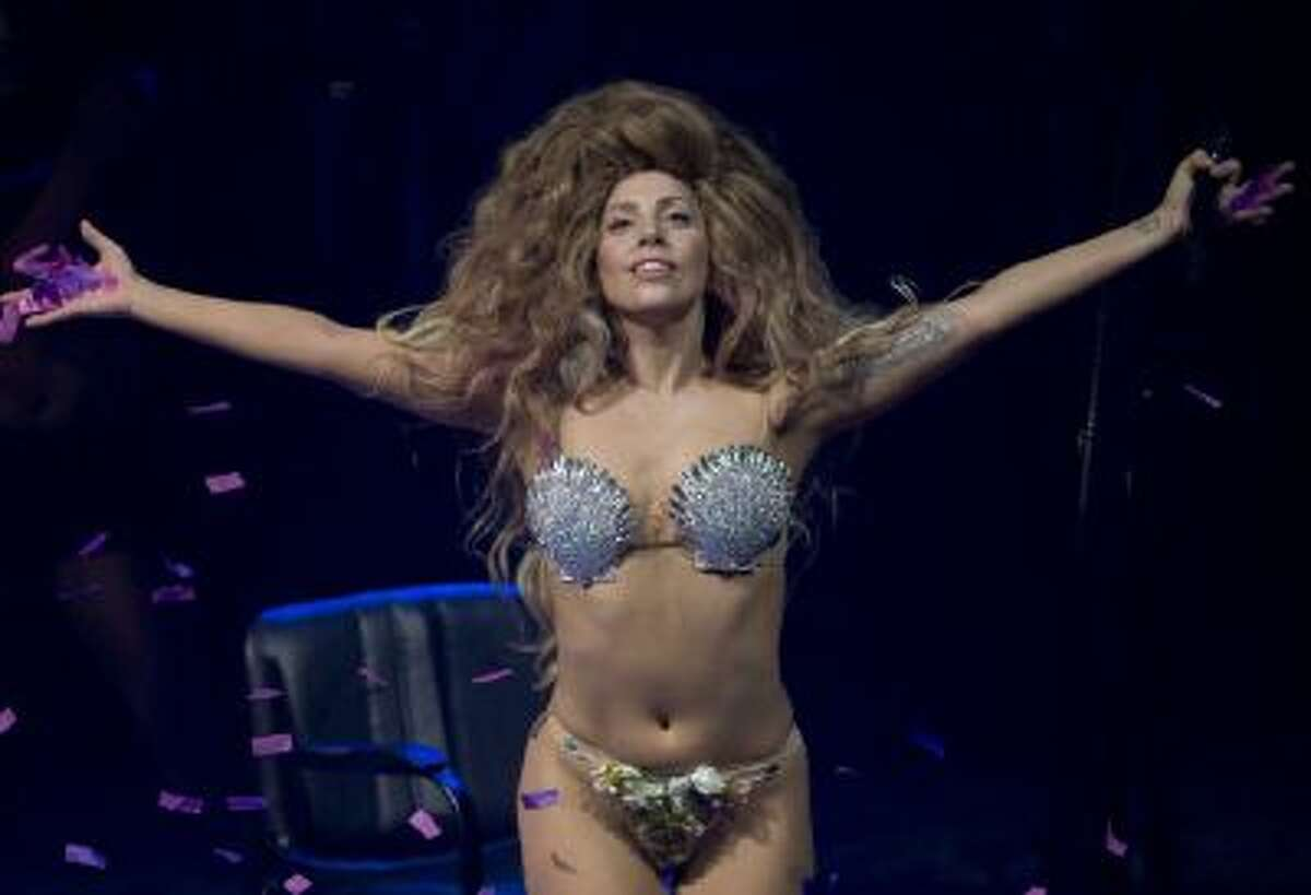 In this Sept. 1, 2013 photo, Lady Gaga performs on stage at the Roundhouse in Camden, north London, as part of the iTunes Festival, the first of 30 nights of live free music in the capital.