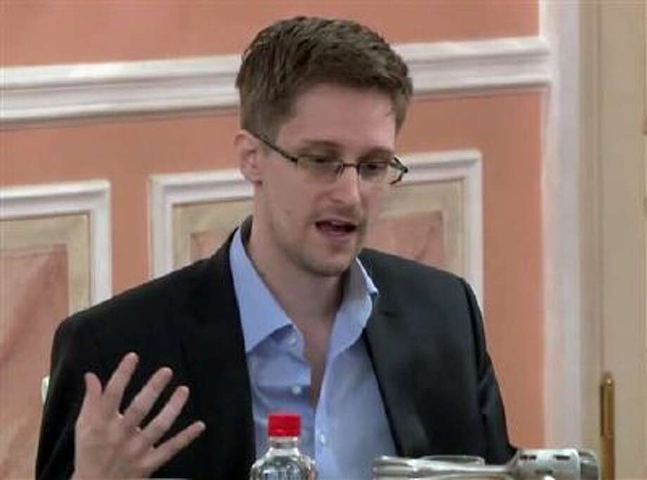 Former National Security Agency systems analyst Edward Snowden speaks during a presentation ceremony Oct. 11 for the Sam Adams Award in Moscow. Photo: AP / WikiLeaks