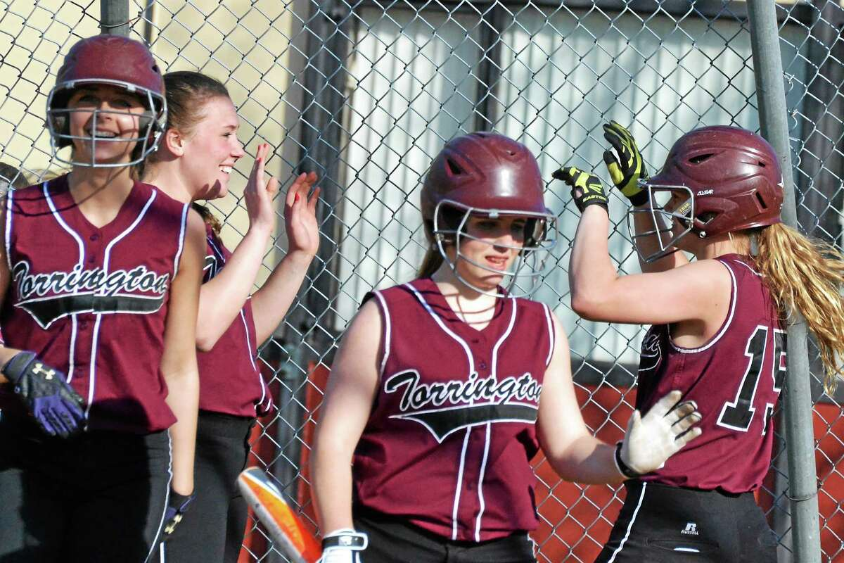 Torrington's Nikki Jamieson (left), credits a lot of the teams success to the fact that the team is getting together better, shown smiling as Brittany Anderson (right) high-fives Sara Heath after scoring against Derby earlier this season.