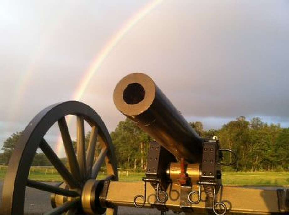 A rainbow provides a backdrop to a Civil War canon on the Gettysburg battlefield during the 150th anniversary of the battle, July 1-3, 2013.