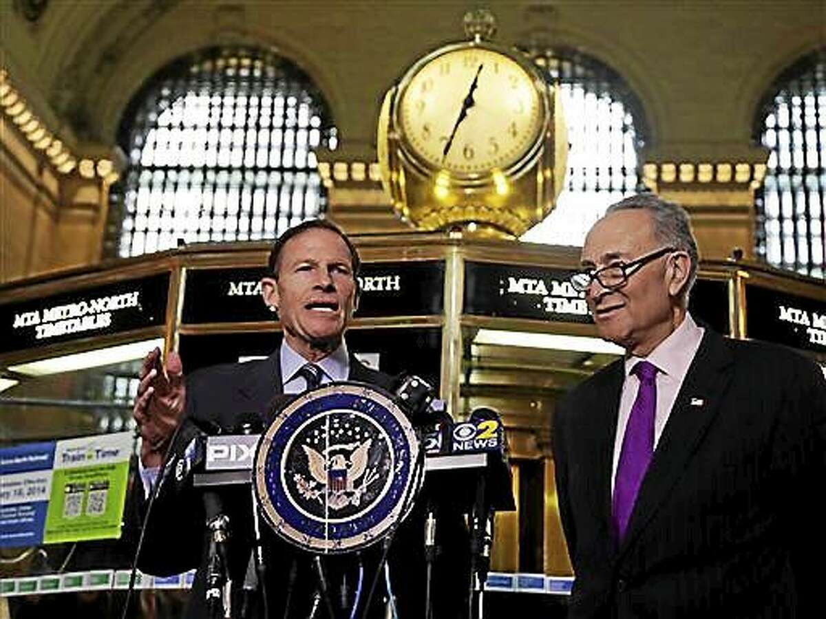 In this March 14, 2014 file photo, U.S. Sen. Richard Blumenthal, D-Conn., left, and U.S. Sen. Charles Schumer, D-N.Y., comment during a news conference on a report by the Federal Railroad Administration about the Metro-North Railroad, at the information booth in New York's Grand Central Terminal.
