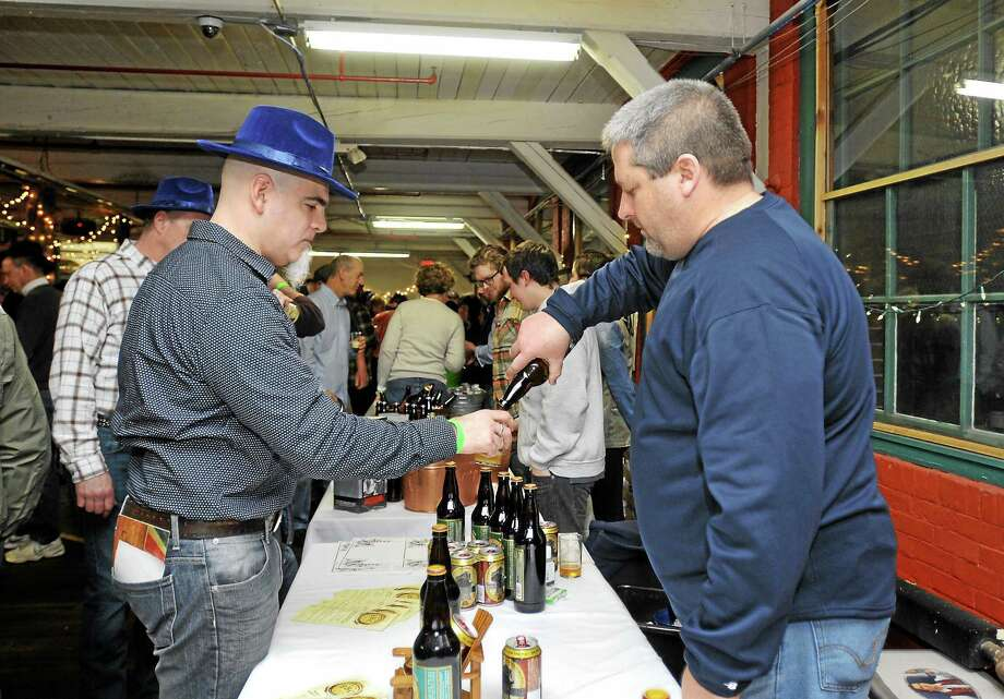 Matt Bronson of the Berkshire Brewing Co. pours a sample for Jeremy Schaller at Pints for a Purpose on Saturday. The innaugural event hosted at Whiting Mills in Winsted included live music and beer tastings from a variety of brewers. Proceeds benefited the Northwest CT YMCA's Strong Kids Campaign. Laurie Gaboardi - The Register Citizen Photo: Journal Register Co.