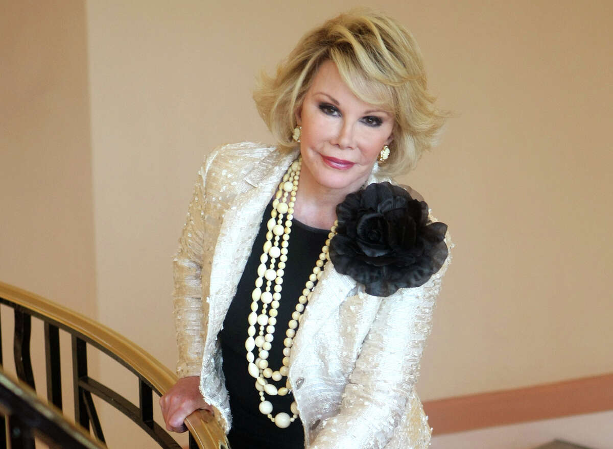 "This Oct. 5, 2009 file photo shows Joan Rivers posing as she presents ""Comedy Roast with Joan Rivers "" during the 25th MIPCOM (International Film and Programme Market for TV, Video, Cable and Satellite) in Cannes, southeastern France. In October 1986, Rivers made TV history as the first woman hosting a late-night broadcast talk show. She was the first face of the Fox network, headlining its first program, ""The Late Show Starring Joan Rivers."""