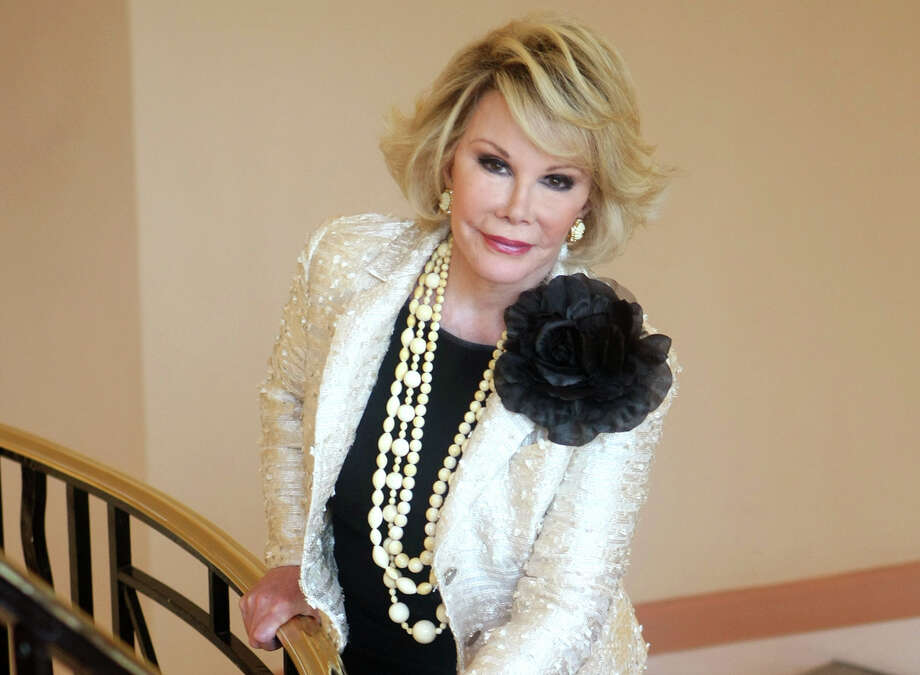"This Oct. 5, 2009 file photo shows Joan Rivers posing as she presents ""Comedy Roast with Joan Rivers "" during the 25th MIPCOM (International Film and Programme Market for TV, Video, Cable and Satellite) in Cannes, southeastern France. In October 1986, Rivers made TV history as the first woman hosting a late-night broadcast talk show. She was the first face of the Fox network, headlining its first program, ""The Late Show Starring Joan Rivers."" Photo: Associated Press  / AP"