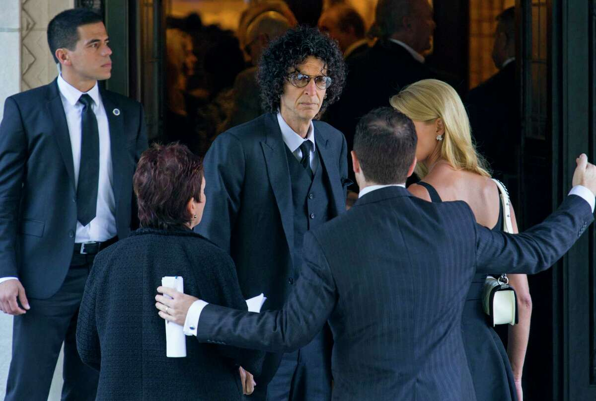 Howard Stern, center, arrives at a funeral service for comedian Joan Rivers at Temple Emanu-El in New York, Sunday, Sept. 7, 2014. Rivers died Thursday, Sept. 4, 2014. She was 81. (AP Photo/Craig Ruttle)