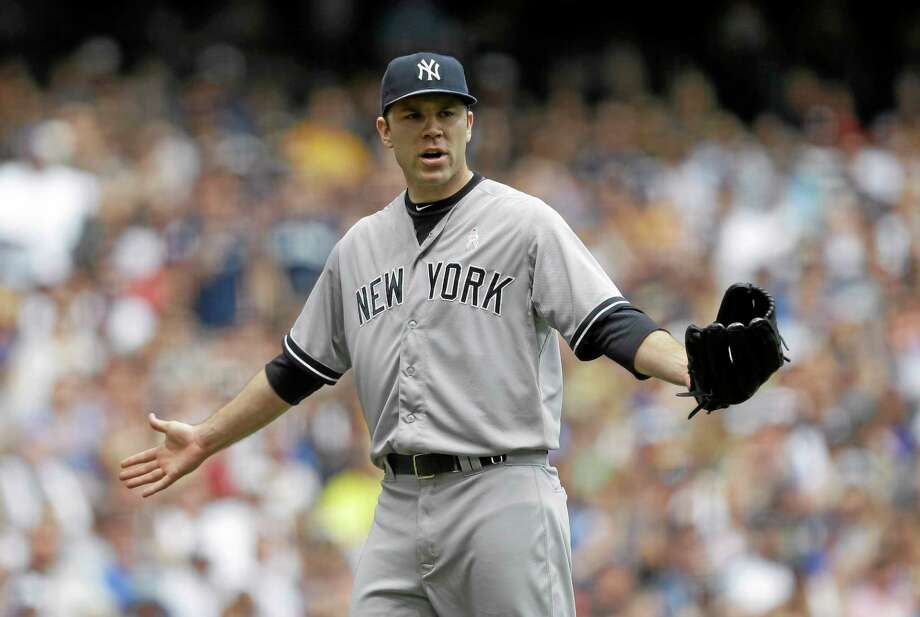 Yankees starting pitcher David Phelps reacts to a balk called on him in the third inning Sunday. Photo: Jeffrey Phelps — The Associated Press  / FR59249 AP