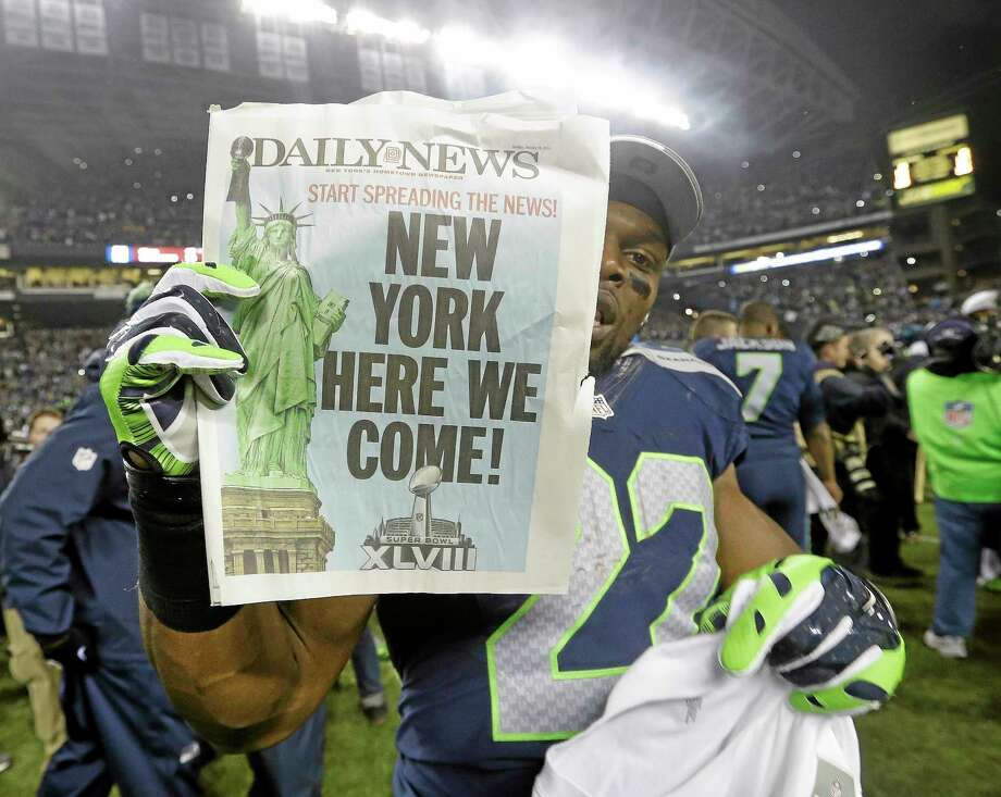 The Seahawks' Robert Turbin celebrates after the NFC championship game against the 49ers on Sunday. Photo: Elaine Thompson — The Associated Press  / AP