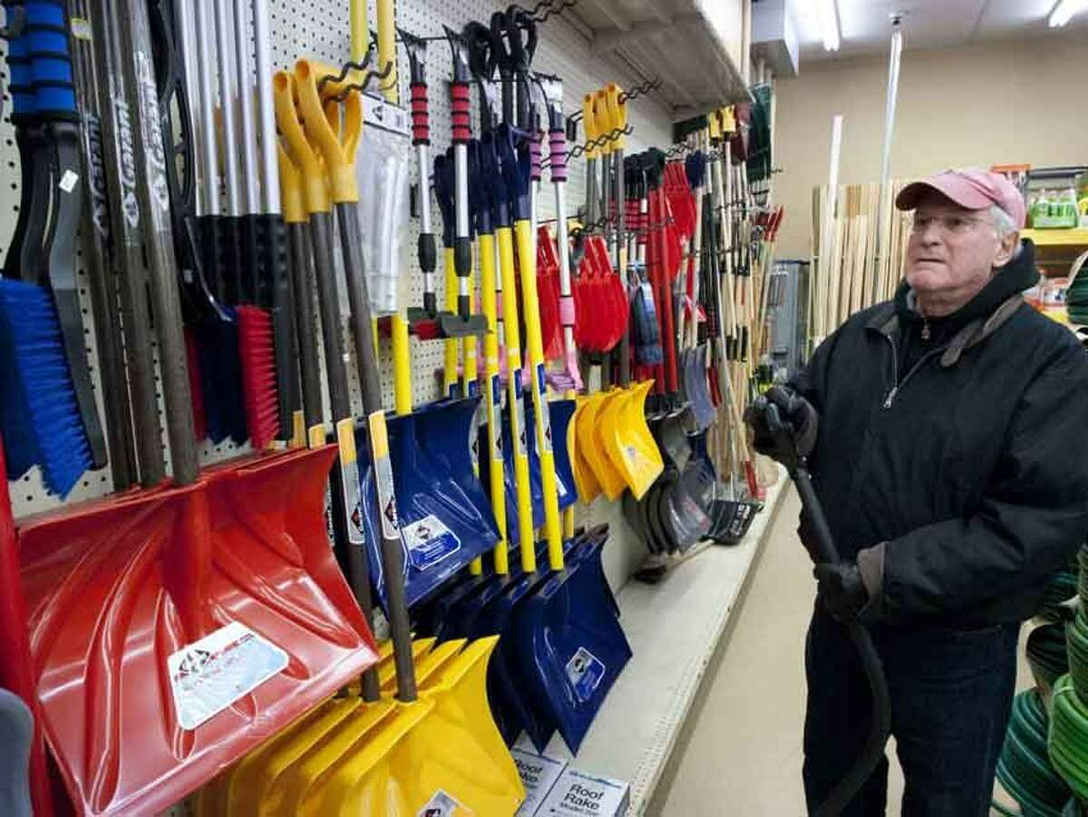 Steve Rosen of East Haven looks over the selection of snow shovels at Goody's Hardware and Paint at 540 Main St. East Haven February 7, 2013 in anticipation of the snow storm predicted for Friday into Saturday. vmWilliams