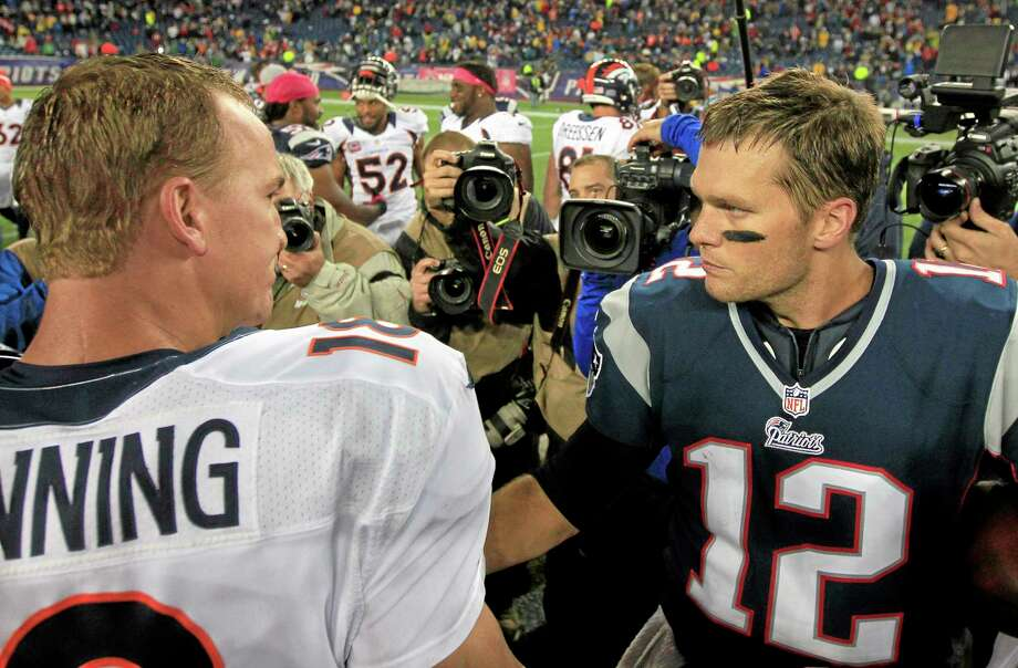 Sunday's meeting between Broncos quarterback Peyton Manning, left, and Patriots quarterback Tom Brady could be the final one of their storied careers. Photo: The Associated Press File Photo  / AP
