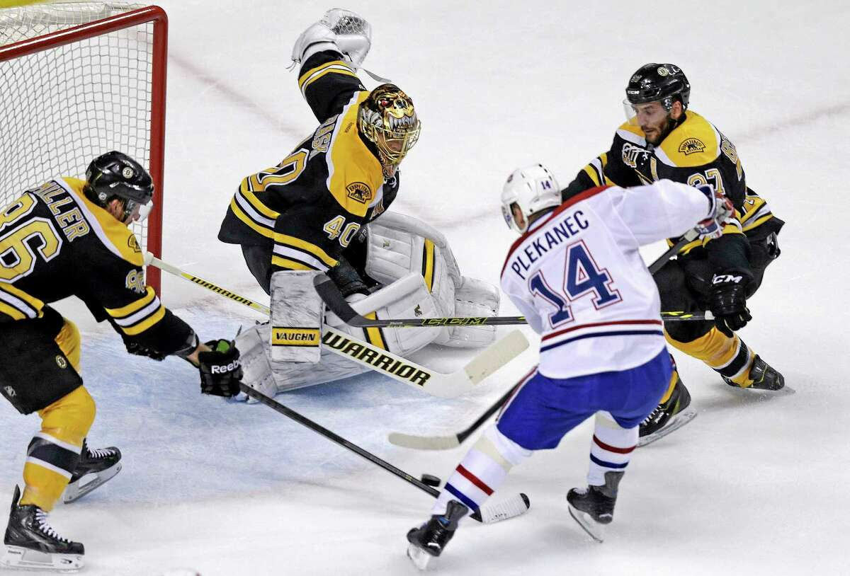 Boston Bruins goalie Tuukka Rask (40) makes the save on a shot by Canadiens center Tomas Plekanec (14) during the first period of Game 5 on Saturday.