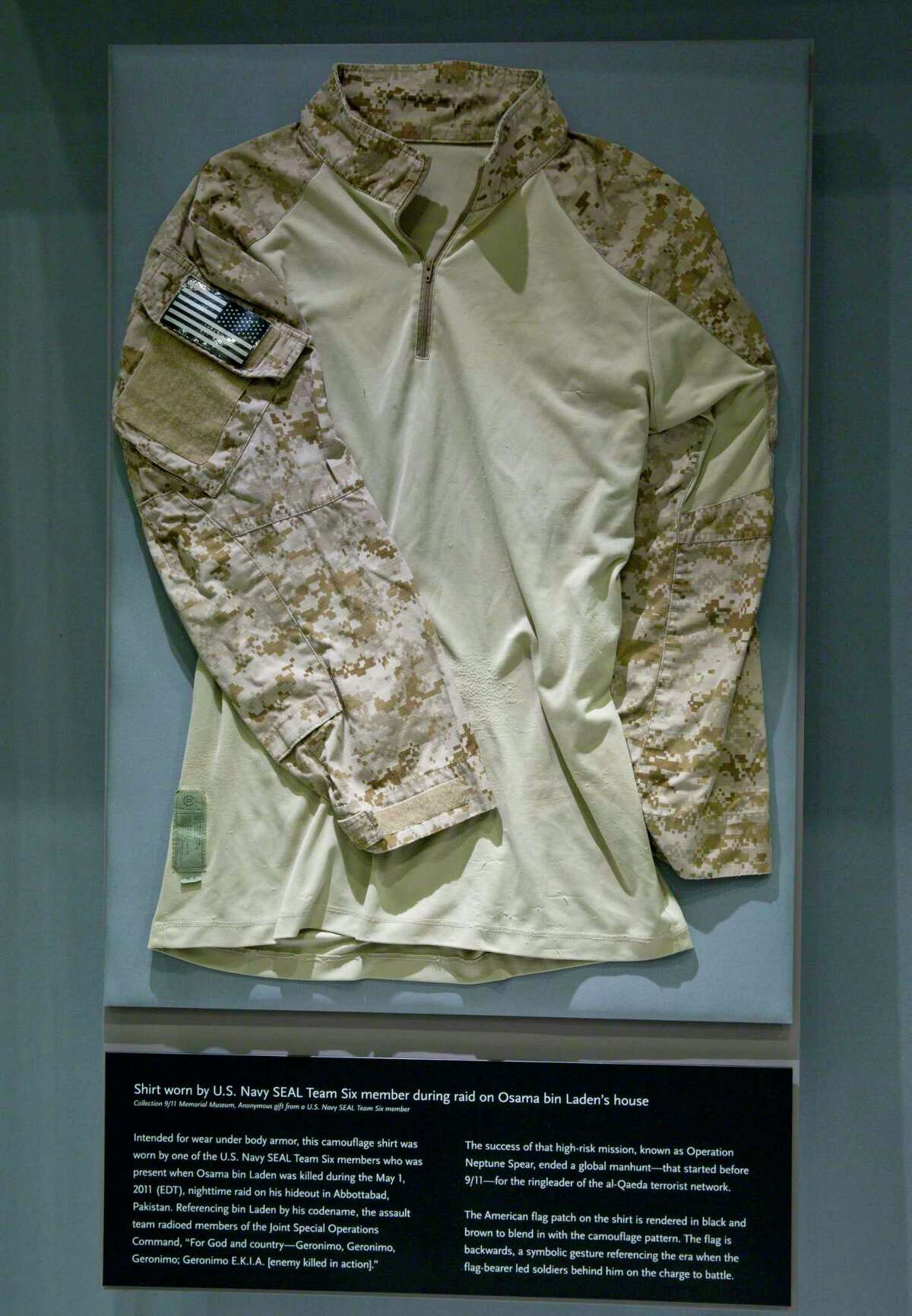 A case containing the fatigue shirt worn by the U.S. Navy SEAL during the mission to capture Osama Bin Laden is seen at the museum in New York. The shirt is among items donated by persons involved with the mission that are part of a new exhibit and will be introduced at the museum on Sunday, Sept. 7.