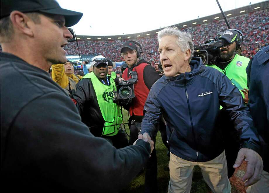 Tensions between 49ers coach Jim Harbaugh, left, and Seahawks coach Pete Carroll date all the way back to their days as college coaches. Photo: The Associated Press File Photo  / AP