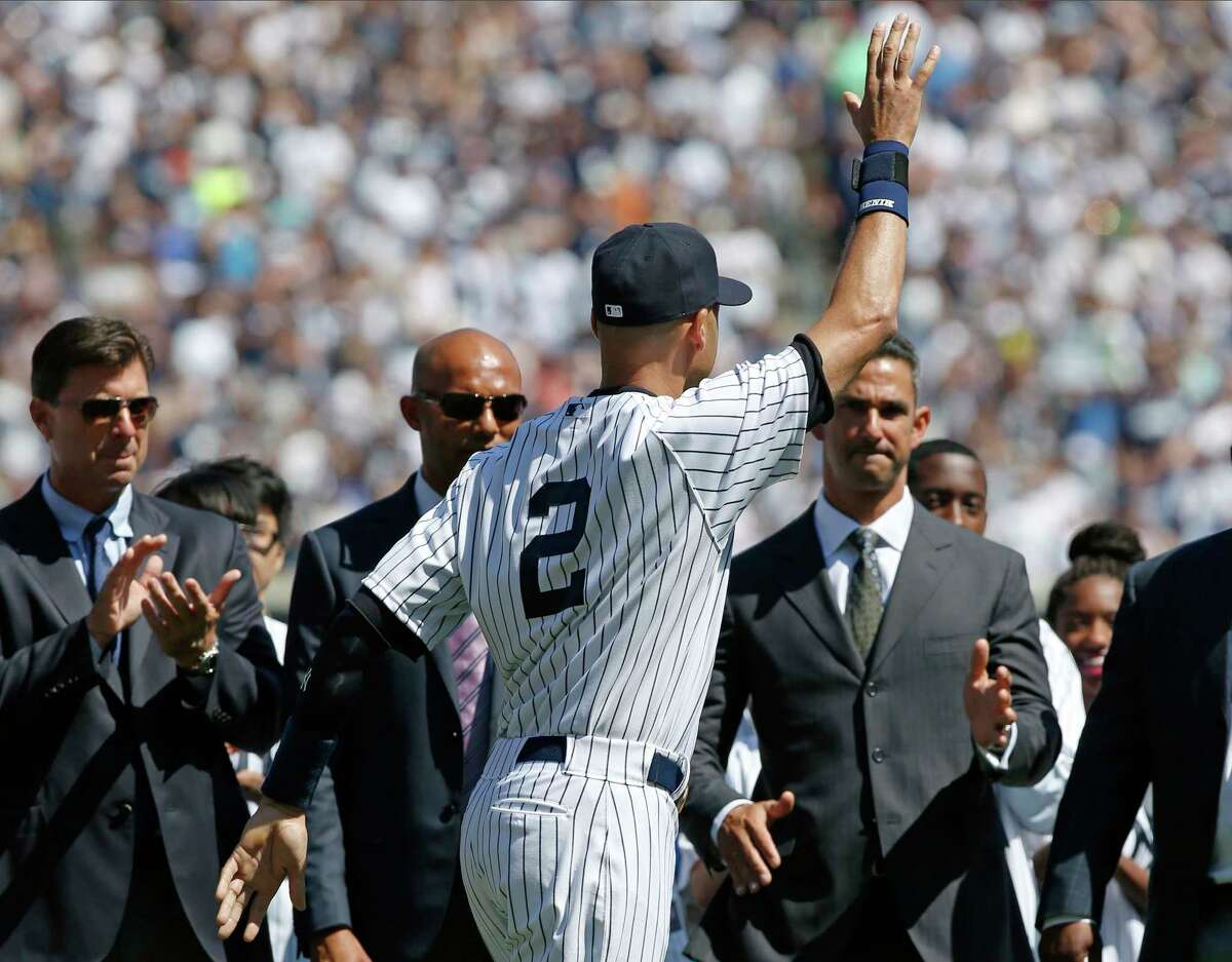 The Associated Press From left, former Yankees first baseman Tino Martinez, former relief pitcher Mariano Rivera and former catcher Jorge Posada, right, applaud New York Yankees shortstop Derek Jeter (2), during a pregame ceremony honoring the Yankees captain who is retiring at the end of the season, on Derek Jeter Day at Yankee Stadium in New York, Sunday, Sept. 7, 2014. game