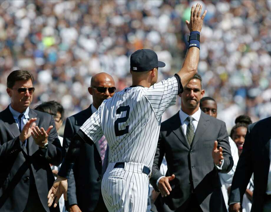 The Associated Press From left, former Yankees first baseman Tino Martinez, former relief pitcher Mariano Rivera and former catcher Jorge Posada, right, applaud New York Yankees shortstop Derek Jeter (2), during a pregame ceremony honoring the Yankees captain who is retiring at the end of the season, on Derek Jeter Day at Yankee Stadium in New York, Sunday, Sept. 7, 2014.  game Photo: AP / AP