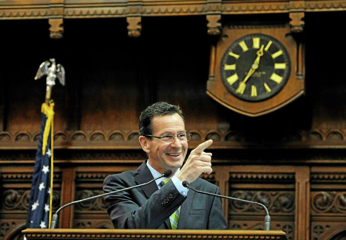 Connecticut Gov. Dannel P. Malloy addresses the House and the Senate at the end of session at the Capitol on the final day of session, Thursday, May 8, 2014, in Hartford, Conn. (AP Photo/Jessica Hill)
