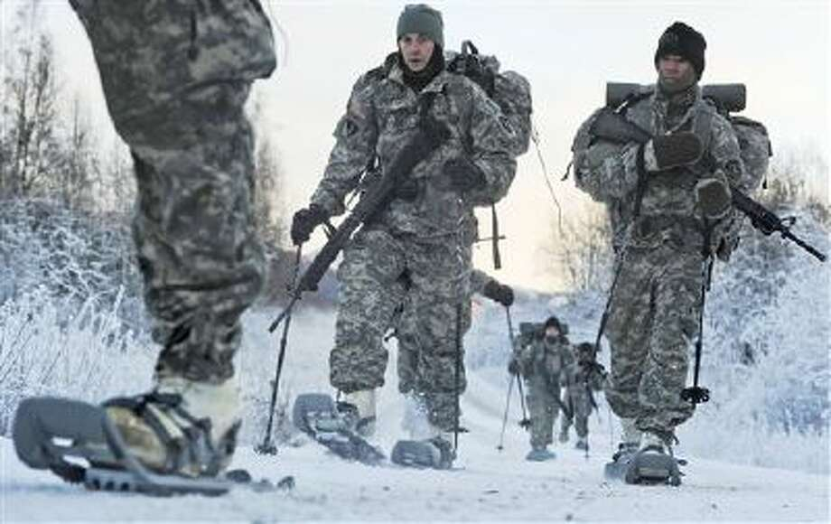 Soldiers assigned to 6th Engineer Battalion utilize snow shoes during Arctic Light Individual Training on the Bulldog Trail in sub-zero conditions at Joint Base Elmendorf-Richardson, Alaska. ALIT is the United States Army Alaska's Cold Weather Indoctrination program. It gives all soldiers, regardless of their job, the foundation to successfully work, train, and go to war in some of the harshest environments in the world. Photo: AP / U.S. Department of Defense