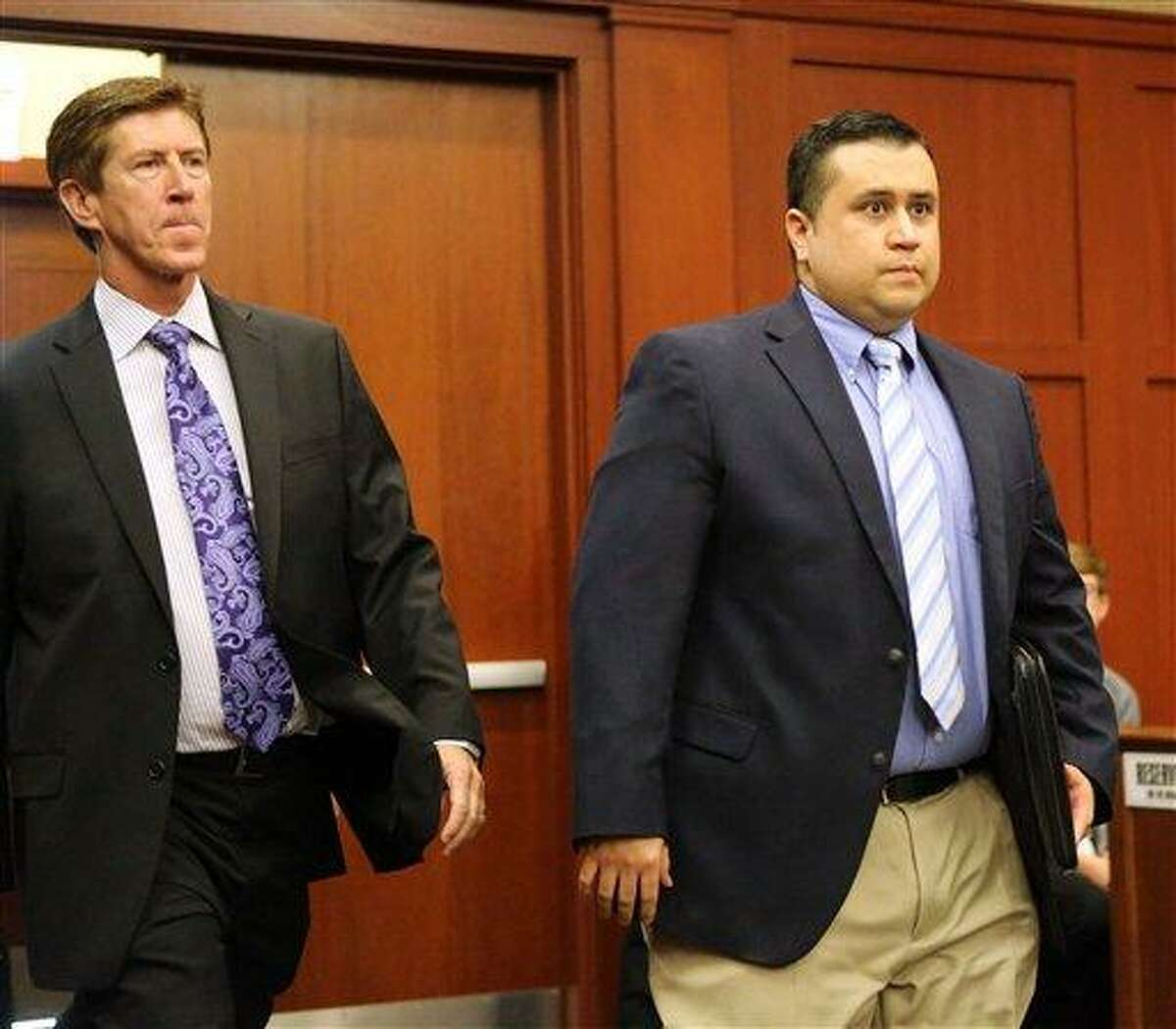 George Zimmerman, right, arrives with his lead counsel, Mark O'Mara, for a hearing in Seminole circuit court, in Sanford, Fla., Tuesday, Feb. 5, 2013. Zimmerman's attorneys presented a motion Tuesday asking Judge Debra Nelson to push the trial from mid-June back to November, but she denied the defense request to delay the trial. Zimmerman is accused of shooting Florida teenager Trayvon Martin last year. He has pleaded not guilty to second-degree murder charges. (AP Photo/Orlando Sentinel, Joe Burbank, Pool)