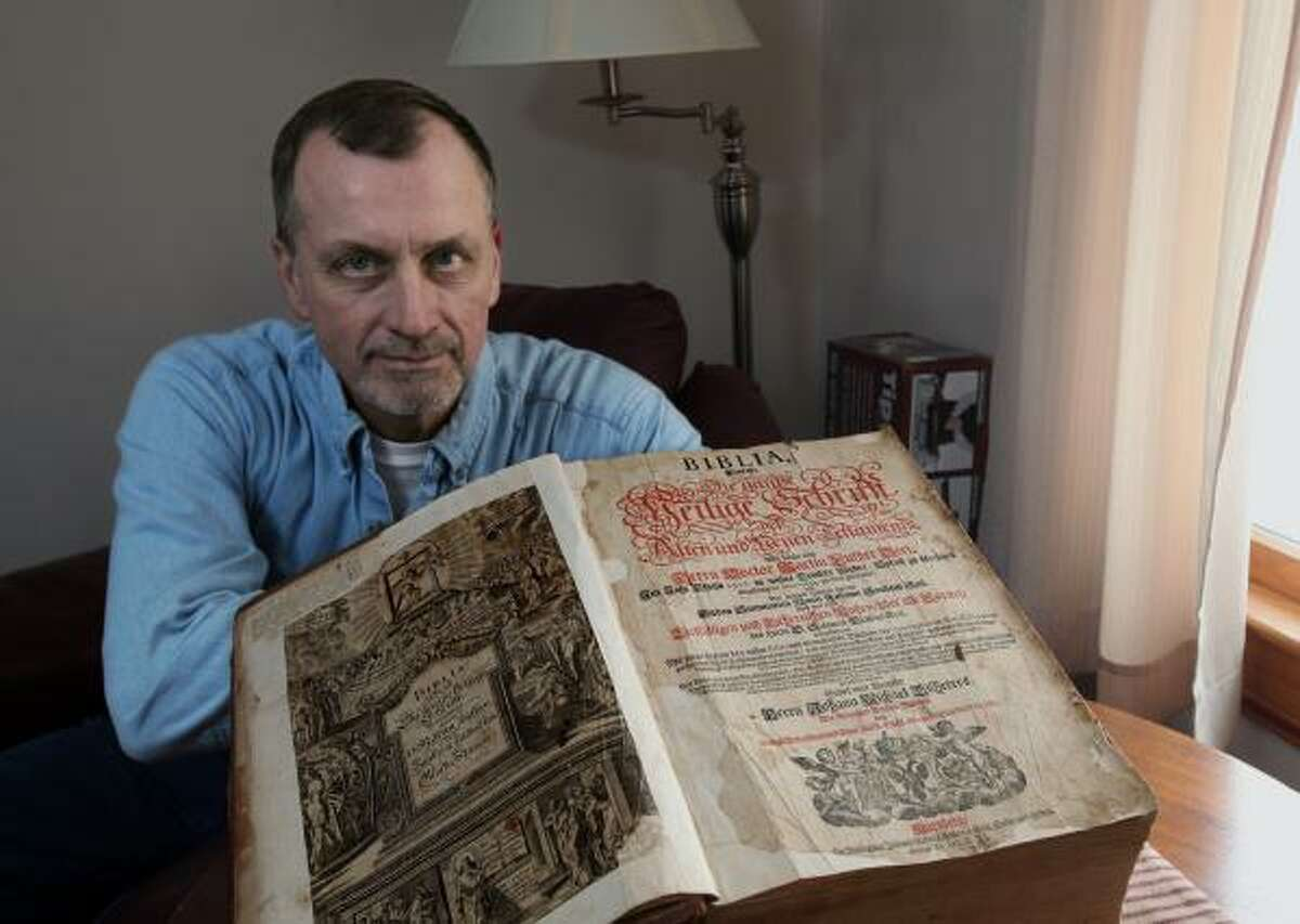 Tim Shier is grateful to have gotten back the family bible dating from the 1700's that was stolen and discarded by thieves in Union County, but miraculously found in Georgia. Photo taken on Feb 3, 2013. (Chris Russell/Dispatch Photo)