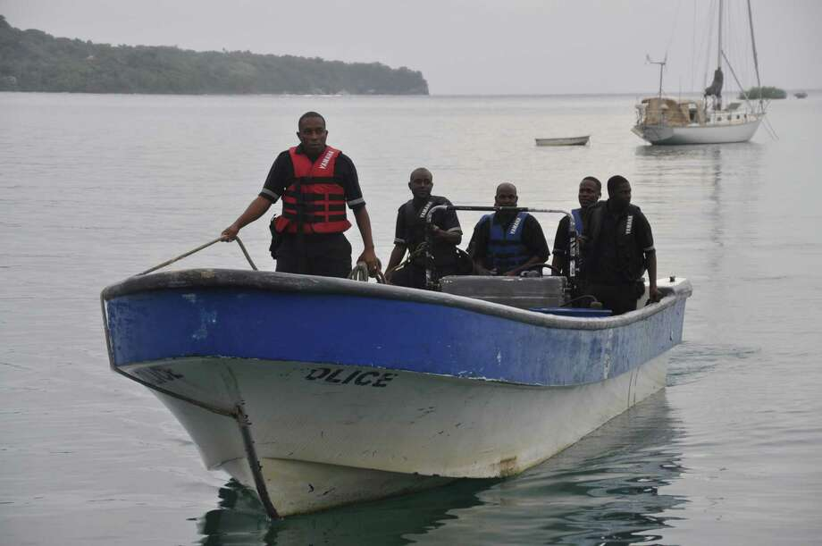 Jamaican Marine Police return to the Port Antonio Marina after a fruitless search for a plane that crashed into the ocean near Port Antonio, Jamaica, Friday, Sept. 5, 2014. A small plane flew down the Atlantic Coast and beyond Friday before finally crashing in the waters off Jamaica. The fate of the two or more people aboard was not immediately known. Maj. Basil Jarrett of the Jamaican Defense Force said the plane went down northeast of the coastal town of Port Antonio and the military dispatched two aircraft and a dive team. (AP Photo/Everard Owen) Photo: AP / AP