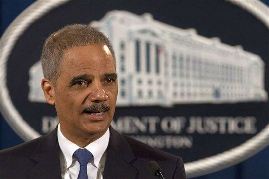 Attorney General Eric Holder speaks at the Justice Department in Washington, Tuesday, Feb. 5, 2013. The U.S. government accused Standard & Poor's of inflating ratings on mortgage investments to boost its bottom line, taking aim at a key player in the run-up to the financial crisis.  (AP Photo/Jacquelyn Martin) Photo: AP / AP