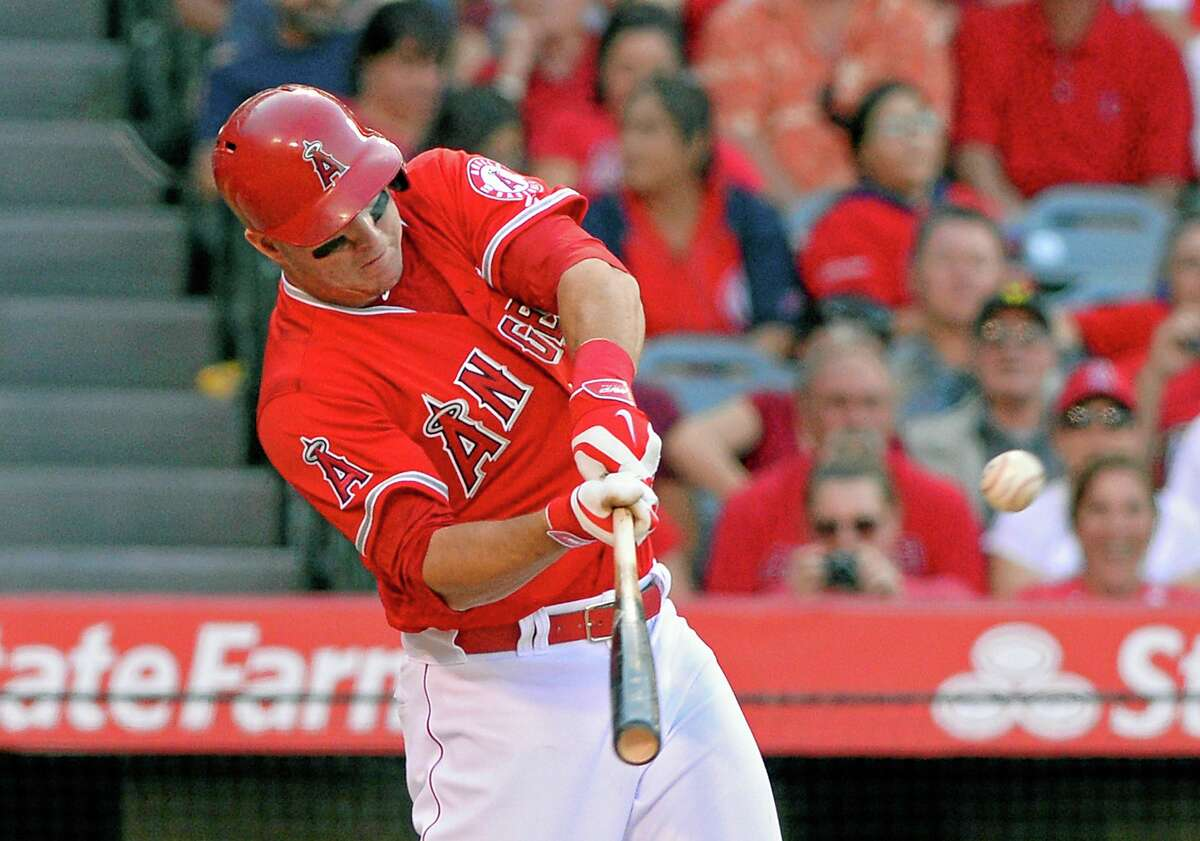 The Angels' Mike Trout hits an RBI double during a game against the Cleveland Indians on April 30 in Anaheim, California.