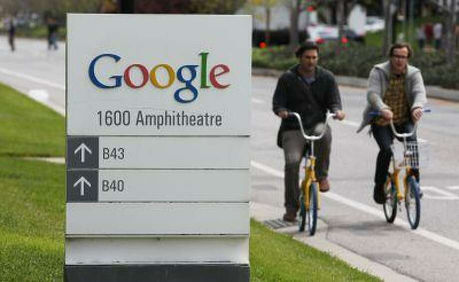 FILE - In this April 12, 2012 file photo, Google workers ride bikes outside of Google headquarters in Mountain View, Calif. Google on Tuesday, June 18, 2013, sharply challenged the federal government's gag order on its Internet surveillance program, citing what it described as a First Amendment right to divulge how many requests it receives from the government for data about its customers in the name of national security. (AP Photo/Paul Sakuma, File) Photo: AP / AP