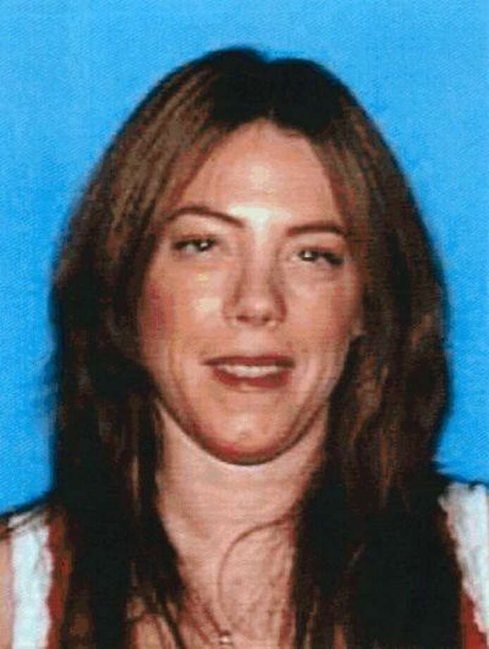 This photo provided by the Department of Motor Vehicles shows Michelle Ann Kane, 43, from the Canoga Park section of Los Angeles, who was killed Saturday, June 15, 2013, one day after she reported to police that her husband had violated a restraining order and vandalized the home they had shared. Michael Rodney Kane, 46, an elementary school teacher accused of chasing down and stabbing his estranged wife to death, was arrested Monday, June 17, 2013. (AP Photo/Department of Motor Vehicles) Photo: AP / DMV