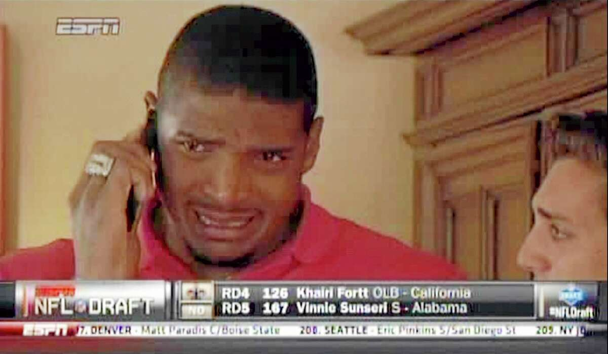 In this image taken from video, Missouri defensive end Michael Sam cries as he talks on a mobile phone at a draft party in San Diego, after he was selected in the seventh round, 249th overall, by the St. Louis Rams in the NFL draft on Saturday.