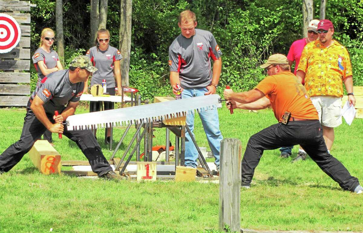 Men compete in a woodcutting event at the 90th annual Bethlehem Fair Saturday.
