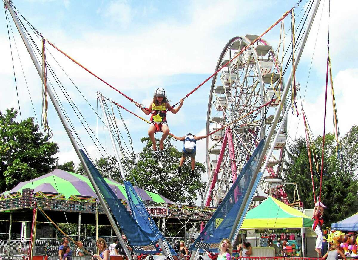 Children enjoy some of the rides at the 90th annual Bethlehem Fair Saturday.