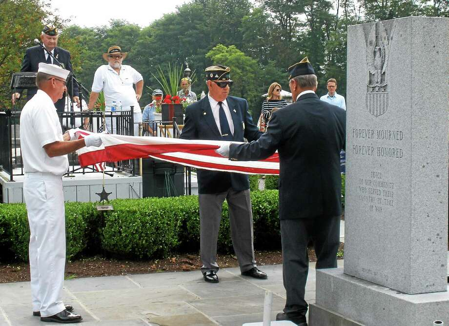 """A ceremony was held Saturday at the All Wars Memorial in Bantam to honor deceased World War II veterans, four brothers known as ìThe Fighting Osowieckis."""" Photo: Stephen Underwood — Special To The Register Citizen"""