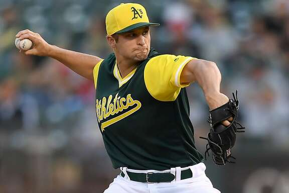 OAKLAND, CA - AUGUST 25:  Kendall Graveman #49 of the Oakland Athletics pitches against the Texas Rangers in the top of the first inning at Oakland Alameda Coliseum on August 25, 2017 in Oakland, California.  (Photo by Thearon W. Henderson/Getty Images)