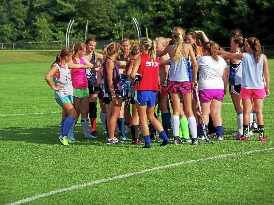 Lewis Mills field hockey huddles during practice this offseason. Photo: Peter Wallace — Register Citizen