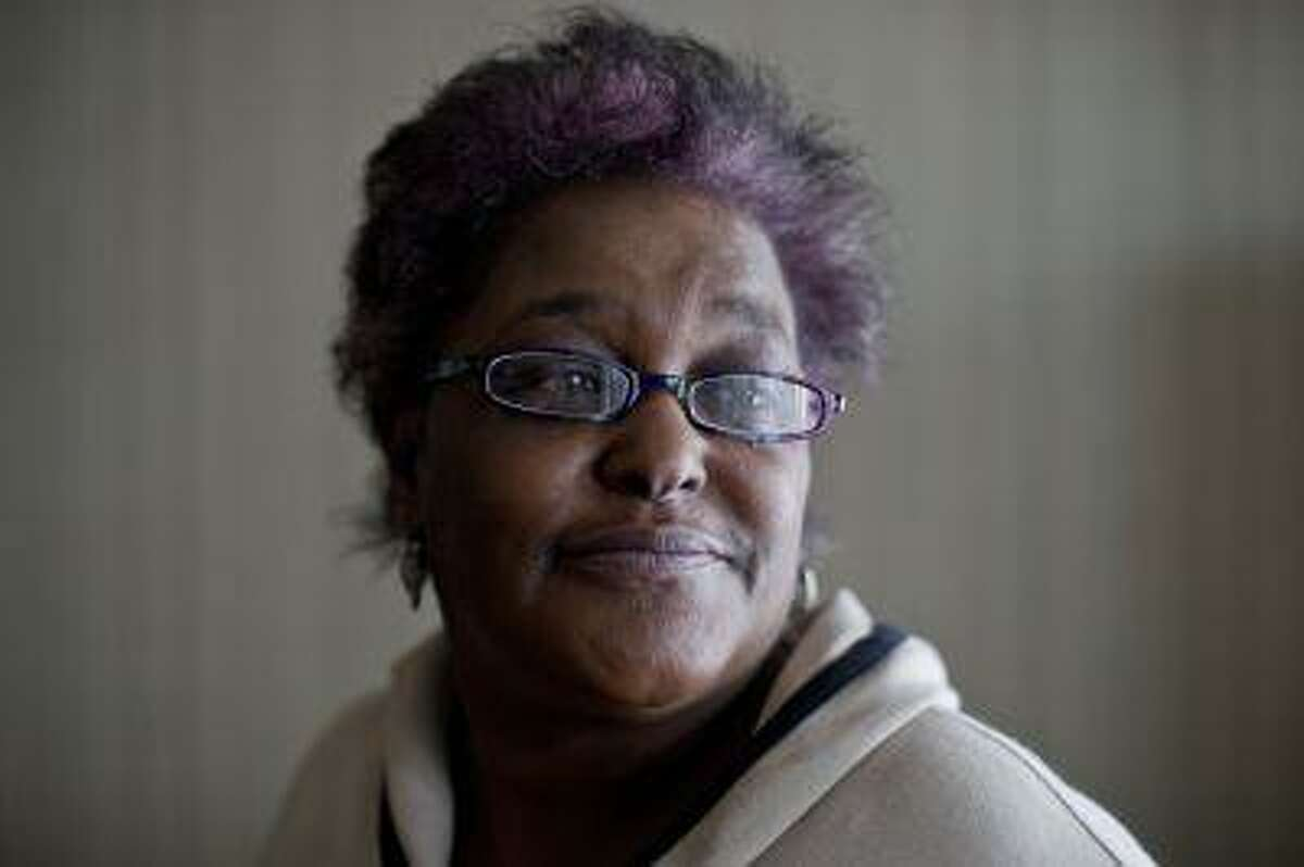 Juliet Carter, 57, was evicted from her apartment after six months' worth of disability benefits was stolen from Direct Express, a card issued by Comerica Bank on behalf of the U.S. Treasury Department. Treasury has been pushing people who prefer paper checks to enroll in Direct Express. (Matt Rourke/AP)
