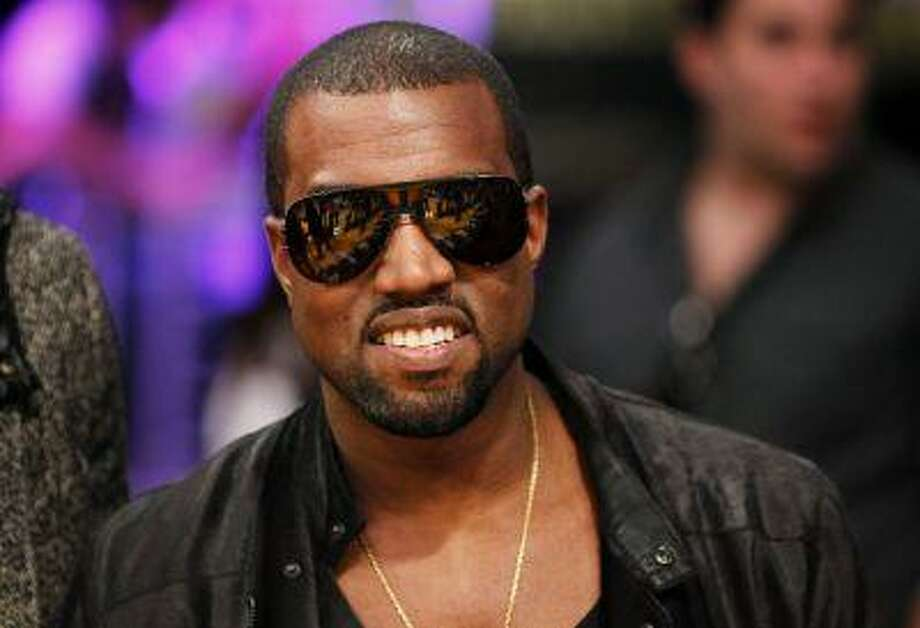 """Recording artist Kanye West attends the NBA basketball game between Miami Heat and Los Angeles Lakers at the Staples Center in Los Angeles in this December 25, 2010 photo. Rapper Kanye West pushes the boundaries of hip hop with his latest album """"Yeezus,"""" using aggressive electro-dance music beats to channel his anger and win over critics, who have called the record """"daring"""" and """"ambitious."""" REUTERS/Danny Moloshok/Files Photo: REUTERS / X01907"""