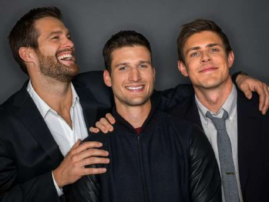"""From left, actors Geoff Stults, Parker Young, and Chris Lowell, of the FOX sitcom """"Enlisted"""" pose for a portrait, on Thursday, Jan. 9, 2014 in New York."""