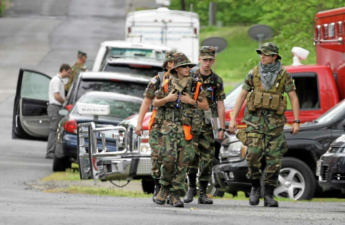 Search teams arrives at a command post for the recovery efforts from a hot air balloon accident in Ruther Glen, Va., Saturday, May 10, 2014. The body of one occupant of a hot air balloon that caught fire after striking a power line and crashed Friday has been recovered and police searched Saturday for two others feared dead, Virginia State Police said. (AP Photo/Steve Helber)