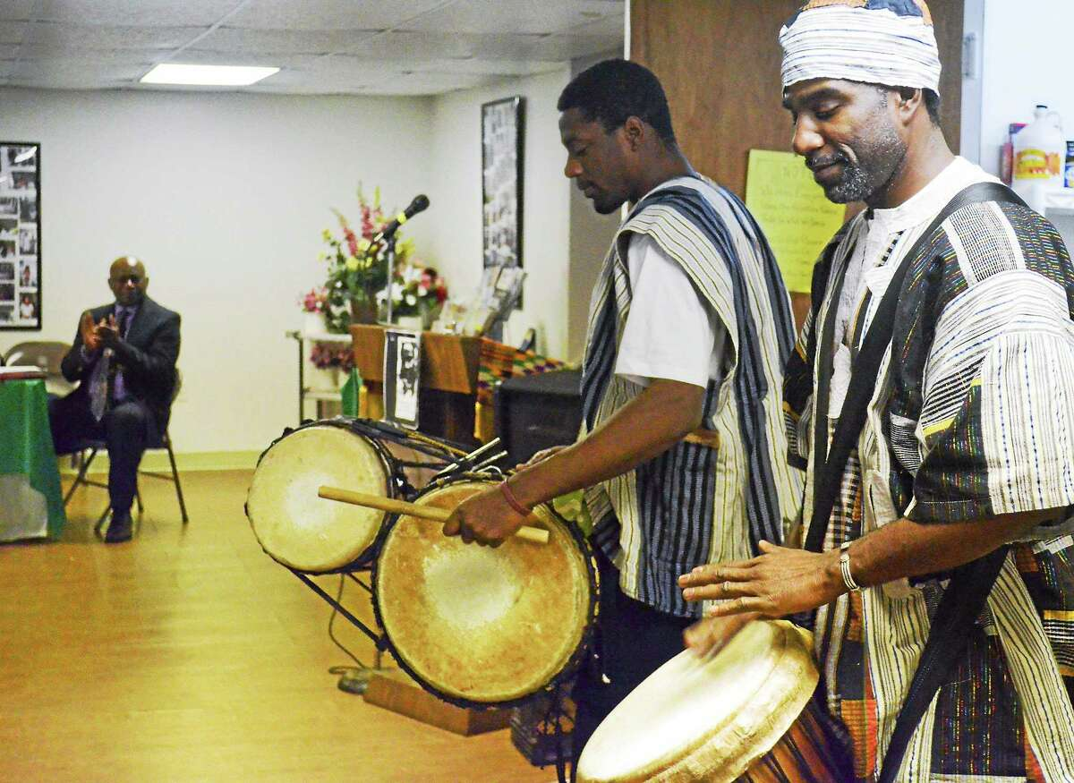Kojo Bey, right, and Thomas Calhoun, members of Sounds of Afrika Drum and Dance Troupe, performed and spoke at the Dr. Martin Luther King Jr. Celebration at Workman Memorial AME Zion Church in Torrington.