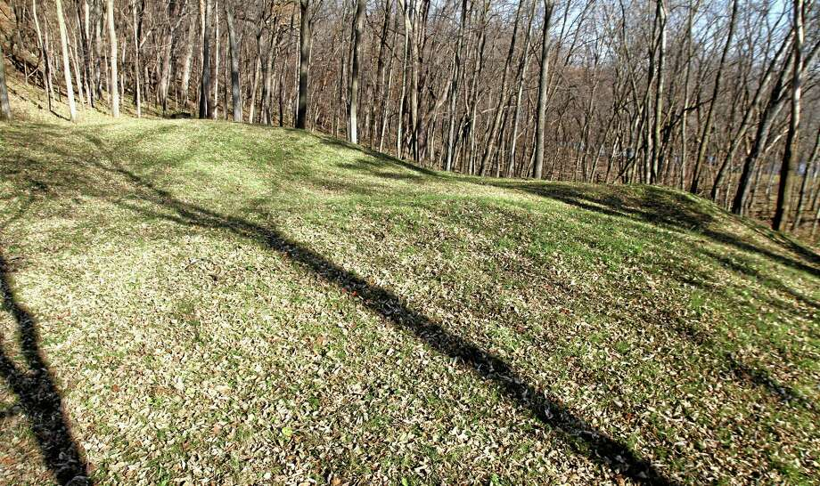"""FILE-- This Nov. 8, 2010, file photo shows the """"Three Mounds"""" site at at Effigy Mounds National Monument in Harpers Ferry, Iowa. Records show that National Park Service officials approved $3 million in illegal construction projects over a decade that damaged one of the nationís most sacred Indian burial sites. (AP Photo/The Des Moines Register, Justin Hayworth, File) MAGS OUT; TV OUT; NO SALES; MANDATORY CREDIT Photo: AP / The Des Moines Register"""