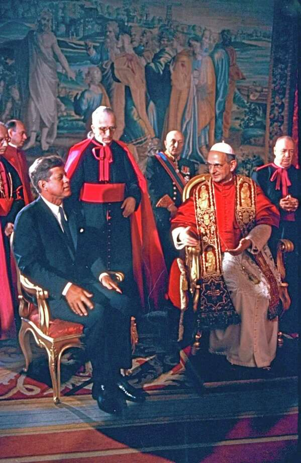 "FILE - In this file photo, taken on July 3, 1963, President Kennedy is shown at the Vatican in an audience with Pope Paul VI.  Pope Francis has approved a miracle credited to the intercession of Paul VI and set the date for the late pontiff's beatification for Oct. 19, the Vatican said Saturday. Francis had authorized the beatification, the last formal step before possible sainthood, a day earlier, the Vatican said. Paul VI, who reigned as pontiff from 1963-1978, made landmark progress in improving Catholics' relationship with other Christians. His papacy is also remembered by his decision, after years of study, to ban contraception for Catholics, in a 1968 encyclical, ""Humanae Vitae"" (""of human life""). (AP Photo) Photo: AP / AP"