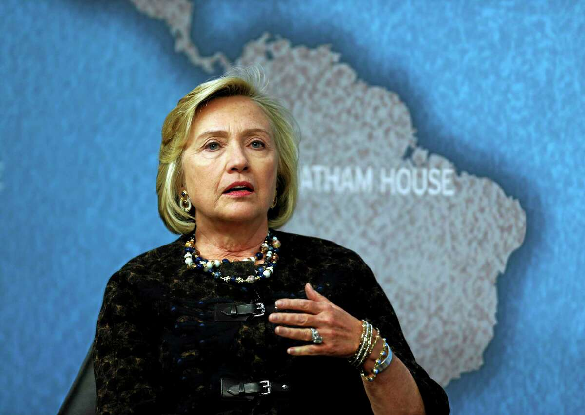 Former U.S. Secretary of State Hillary Clinton gestures as she talks during an event at Chatham House in London, Friday, Oct. 11, 2013. (AP Photo/Lefteris Pitarakis)