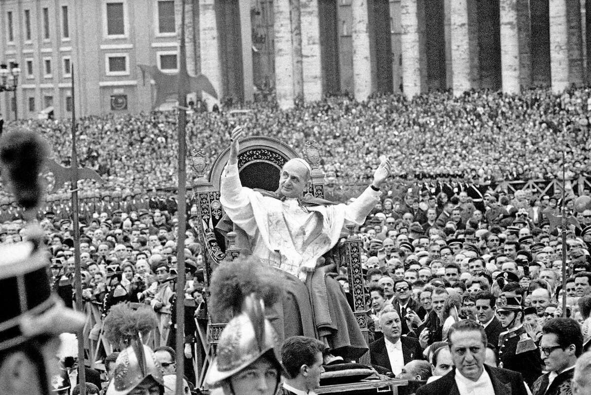 FILE -- In this file photo taken on March 29, 1964, Pope Paul VI salutes a crowd estimated at 200,000 as he is carried on portable throne through St. Peter's Square in Vatican City. Pope Francis has approved a miracle credited to the intercession of Paul VI and set the date for the late pontiff's beatification for Oct. 19, the Vatican said Saturday. Francis had authorized the beatification, the last formal step before possible sainthood, a day earlier, the Vatican said. Paul VI, who reigned as pontiff from 1963-1978, made landmark progress in improving Catholics' relationship with other Christians. His papacy is also remembered by his decision, after years of study, to ban contraception for Catholics, in a 1968 encyclical,