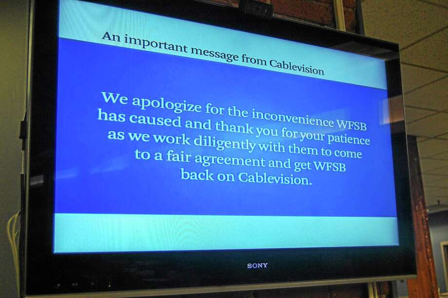A looped message display on WFSB during the blackout as the channel was pulled because of a contract dispute with Cablevision. Photo: Register Citizen File Photo