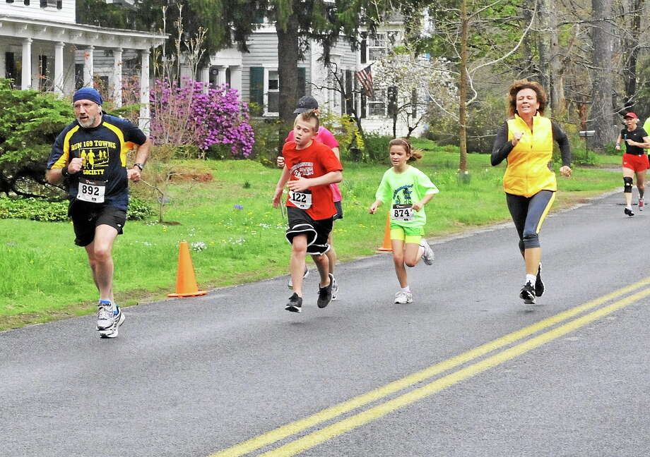 Runners flocked to Barkhamsted Saturday for the annual River Run 5K to benefit the fifth-grade class at Barkhamsted Elementary School. Photo: Laurie Gaboardi — Register Citizen
