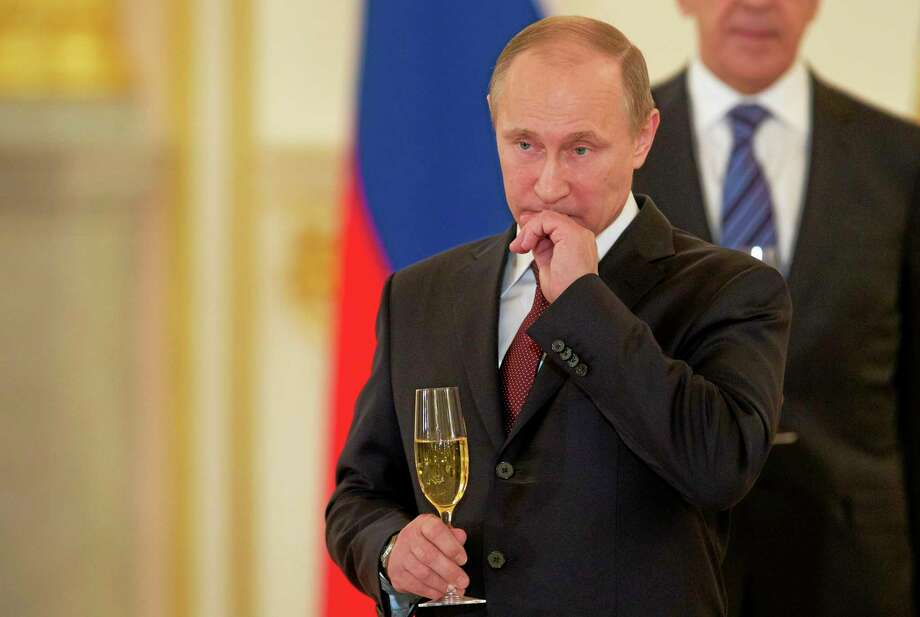 Russian President Vladimir Putin attends a ceremony of presentation of credentials by foreign ambassadors in the Kremlin in Moscow, Russia, Thursday, Jan. 16, 2014. (AP Photo/Ivan Sekretarev) Photo: AP / AP