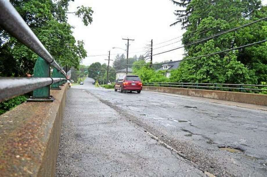 A car drives over the Holabird Avenue bridge in Winsted on Thursday, June 13. It is one of the structurally deficient bridges in Connecticut, according to a recent report.(Tom Caprood-Register Citizen)
