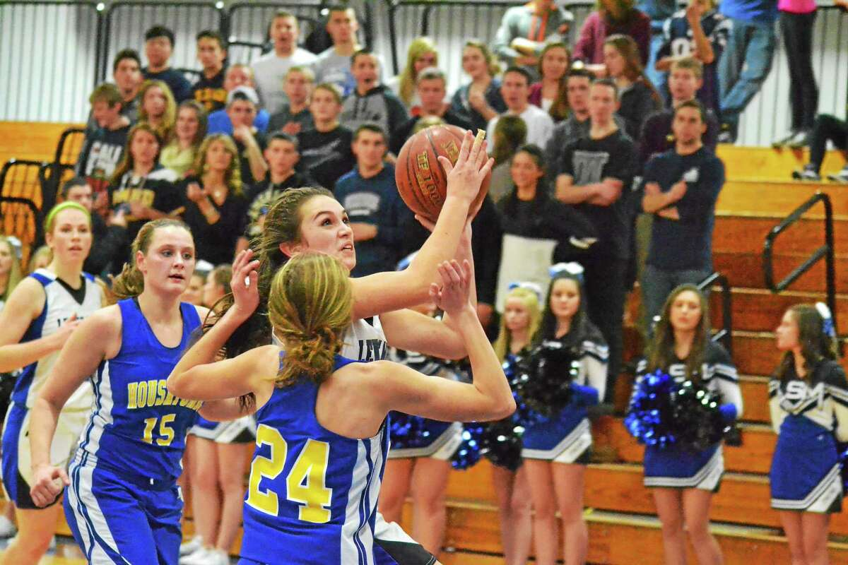 Lewis Mills' Natalie Ruel goes for a layup over Housatonic's Chelsea Kearns in the Spartans 49-41 win over the Moutaineers. Ruel finished with a game high 17 points.