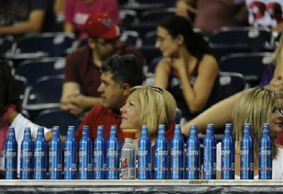 Football fans line up 17 beer bottles during the second half of an NFL preseason football game between the Houston Texans and the Minnesota Vikings Thursday, Aug. 30, 2012, in Houston. The Texans won 28-24.(AP Photo/Pat Sullivan) Photo: AP / AP