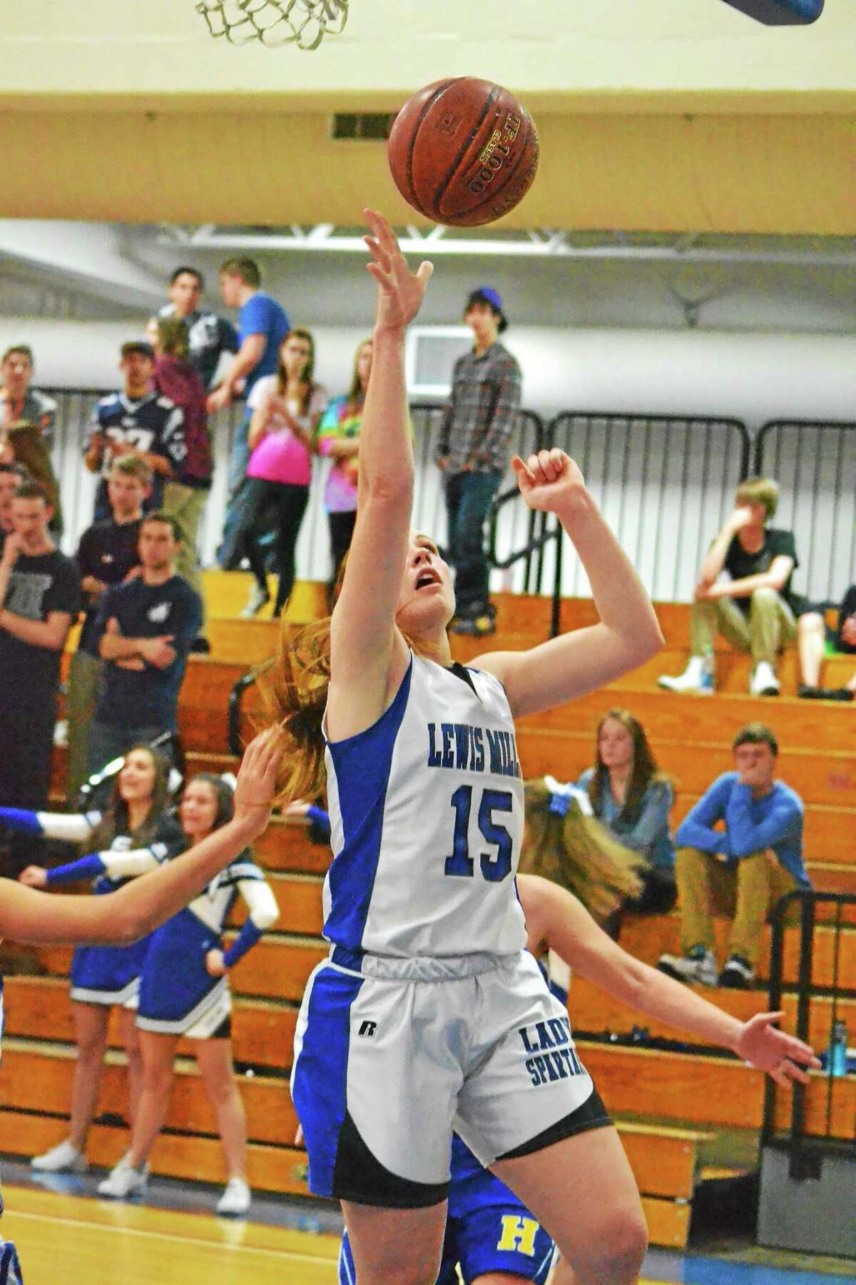 Lewis Mills' Teagan Dunn puts up a layup in the Spartans 49-41 win over Housatonic.
